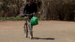 Township man on bicycle Stock Footage