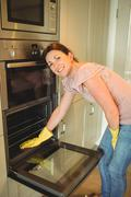 Woman cleaning the oven at home - stock photo