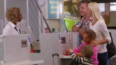 Family Going On Vacation Checking In At Airport Shot On R3D Stock Footage
