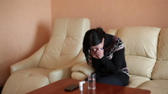 Young girl sitting on the couch, sneezing, feels bad. Colds Stock Footage