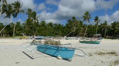 Blue catamaran boat at Anda beach Stock Footage