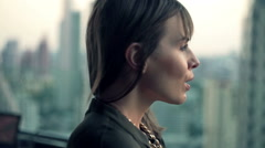 Young, pensive woman admire view from terrace Stock Footage