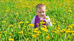 Cute girl on flower field in sunny day Stock Footage