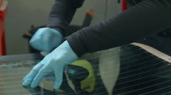 Cleaning the back window after the glue has been put on it Stock Footage