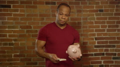 Planning for retirement - Middle Aged Model with Piggy Bank Stock Footage
