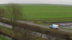 Aerial close up white van moving behind trees driving rural road delivery truck Arkistovideo