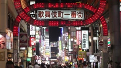 TOKYO RED LIGHT DISTRICT AT NIGHT,PEOPLE BUSTLING,NEON LIGHT,SEX SHOP - stock footage