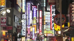 PAN SHOT TOKYO RED LIGHT DISTRICT AT NIGHT,PEOPLE BUSTLING,NEON LIGHT,SEX SHOP - stock footage