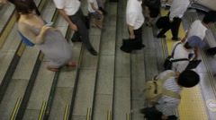 WIDE SHOT OF COMMUTERS AT TOKYO TRAIN STATION DURING RUSH HOUR Stock Footage