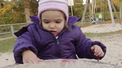 Playing in a sandbox - stock footage