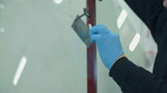 Worker is mending a broken glass on the front window Stock Footage