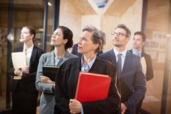 Legal team looking up together at the office Stock Photos