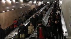 WIDE SHOT OF COMMUTERS ON ESCALATOR AT TRAIN STATION RUSH HOURS IN TOKYO Stock Footage