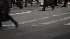 MEDIUM SHOT OF COMMUTERS FEET CROSSING INTERSECTION DURING RUSH HOUR IN TOKYO Stock Footage