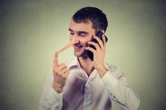 Liar customer service representative. Happy young man with long nose talking  Stock Photos