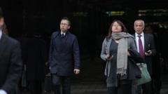 CROWD OF COMMUTERS WALKING IN TOKYO JAPAN Stock Footage