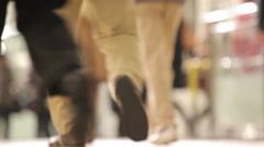 TIGHT SHOT OF COMMUTERS SHOES WALKING AT TOKYO TRAIN STATION DURING RUSH HOUR - stock footage