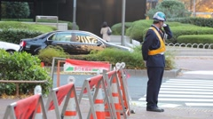 A TEMP WORKER WORKS AT CONSTURCTION SITE ON THE STREET IN JAPAN Stock Footage