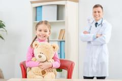 Little girl having appointment with her pediatrician - stock photo