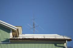 TV Antenna on Snow Covered Roof Stock Photos