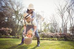 Cute couple doing some gardening activities outside - stock photo