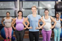 Female trainer with pregnant woman at the leisure center Kuvituskuvat
