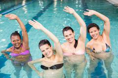 Pregnant women doing aqua aerobics  at the leisure centre Stock Photos