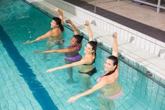Pregnant women doing aqua aerobics at the leisure center Stock Photos