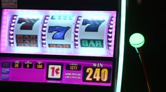 TIGHT SHOT OF SLOT MACHINES DISPLAY AT CASINO - stock footage