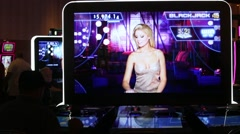 TIGHT SHOT OF BLACK JACK MACHINES AT CASINO - stock footage