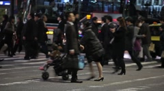 Tokyo commuters crossing busy intersection during rush hour .mp4 Stock Footage
