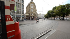 Tram traveling  down the Street Downtown -  The Hague Netherlands Stock Footage