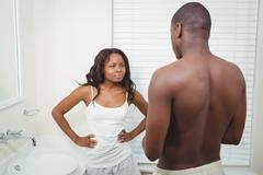 Ethnic couple having an argument in the bathroom Stock Photos