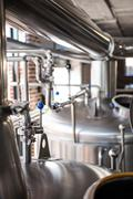 Large vats of beer at the local brewery - stock photo