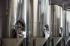 Large vat of beer at the local brewery - stock photo