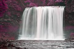 Beautiful alternate colored surreal waterfall landscape Stock Photos