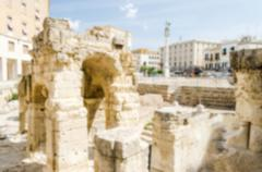 Defocused background with Roman amphitheatre in Sant'Oronzo square, Lecce Stock Photos