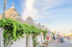 Defocused background with typical trulli buildings in Alberobello, Apulia, It Stock Photos