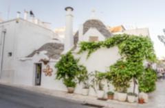 Stock Photo of Defocused background with typical trulli buildings in Alberobello, Apulia, It