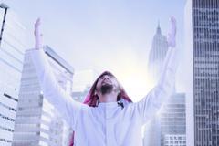 Arabic businessman praying outdoors Stock Photos