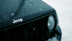 Snow Falling on the hood of a Jeep Patriot, Slow Motion, Medium, Above - stock footage