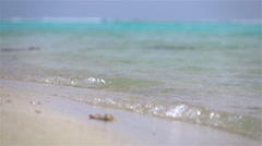 SLOW MOTION CLOSE UP: Small ocean waves washing onshore Stock Footage