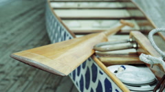 Paddle sitting in a Dragon Boat Stock Footage