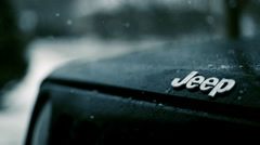 Snow Falling on the hood of a Jeep Patriot, Slow Motion, CloseUp - stock footage