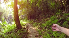 Man Hiking along a Nature Trail with Strange, Alternating Hand Movements - stock footage