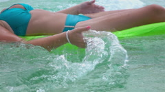 CLOSE UP: Woman swimming with water air bed in ocean - stock footage