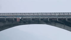 Metro Bridge With Car and Train Stock Footage