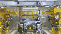 Industrial robots in production cars Stock Footage