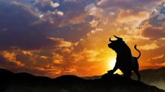 Stock Market Bull Silhouette at Sunrise 4K Loop Stock Footage