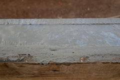 wet cement for build beam of wall - stock photo